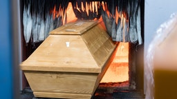 A coffin is moved for cremation into the furnace at the crematorium in Meissen, eastern Germany on January 13, 2021, during the ongoing novel coronavirus (Covid-19) pandemic.