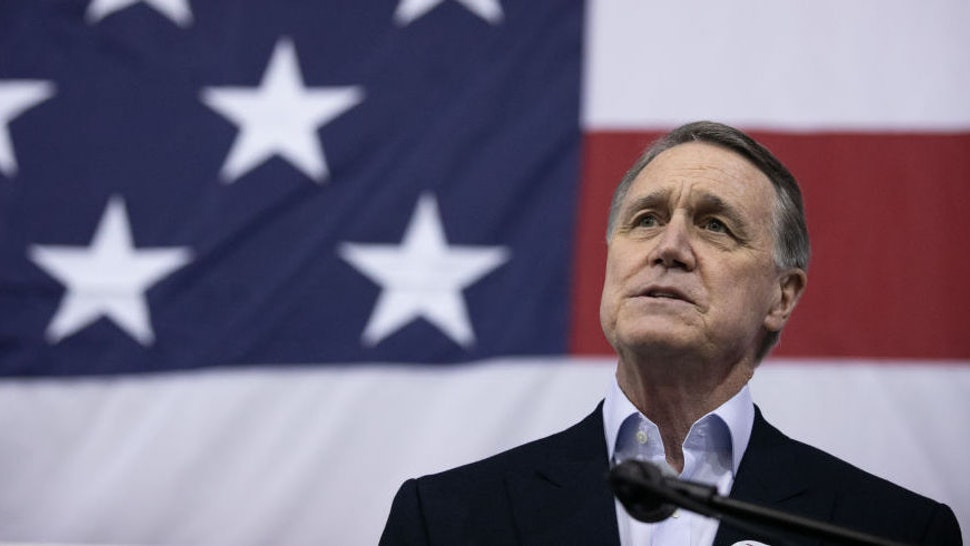 ATLANTA, GA - DECEMBER 14: Sen. David Perdue (R-GA) addresses the crowd during a campaign rally at Peachtree Dekalb Airport on December 14, 2020 in Atlanta, Georgia. As early voting begins, Perdue is facing Democratic candidate Jon Ossoff in a runoff election. The results of two Georgia Senate races will determine the party that controls the majority in the U.S. Senate.