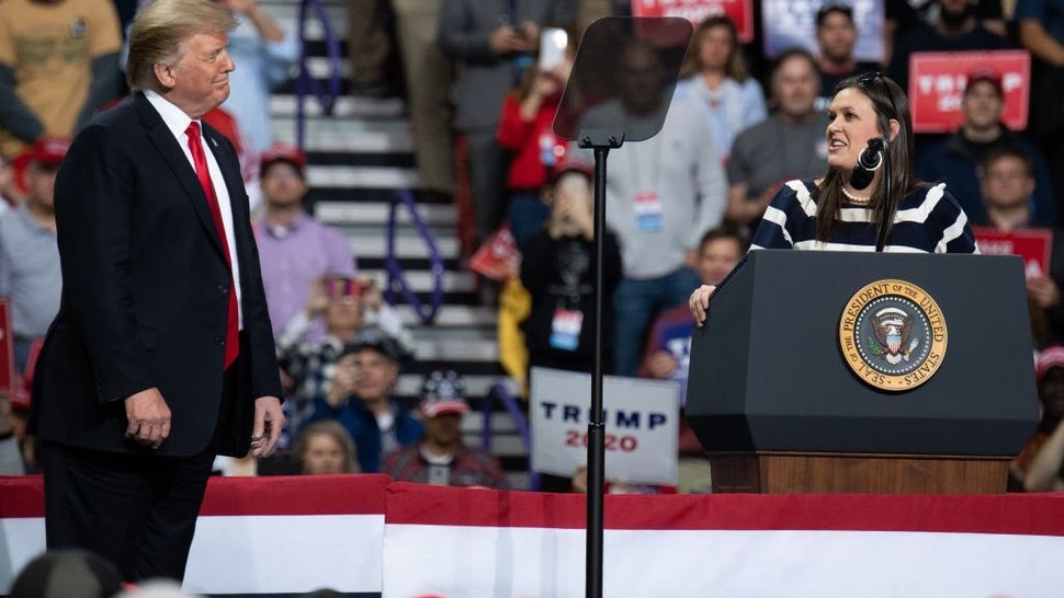 White House Press Secretary Sarah Huckabee Sanders (R) speaks alongside US President Donald Trump during a Make America Great Again rally in Green Bay, Wisconsin, April 27, 2019. (Photo by SAUL LOEB / AFP) (Photo credit should read SAUL LOEB/AFP via Getty Images)