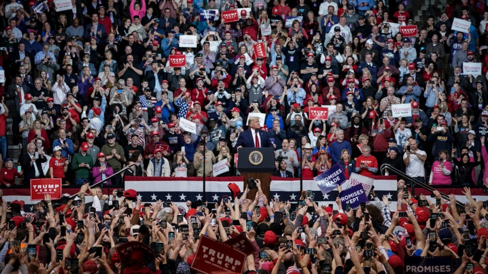 """Supporters cheer as U.S. President Donald Trump arrives for a """"Keep America Great"""" rally at Southern New Hampshire University Arena on February 10, 2020 in Manchester, New Hampshire."""