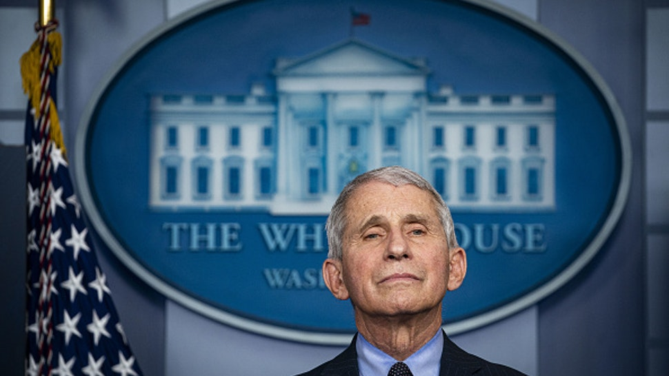 Anthony Fauci, director of the National Institute of Allergy and Infectious Diseases, listens during a news conference in the James S. Brady Press Briefing Room at the White House in Washington, D.C., U.S., on Thursday, Jan. 21, 2021. Biden in his first full day in office plans to issue a sweeping set of executive orders to tackle the raging Covid-19 pandemic that will rapidly reverse or refashion many of his predecessor's most heavily criticized policies.