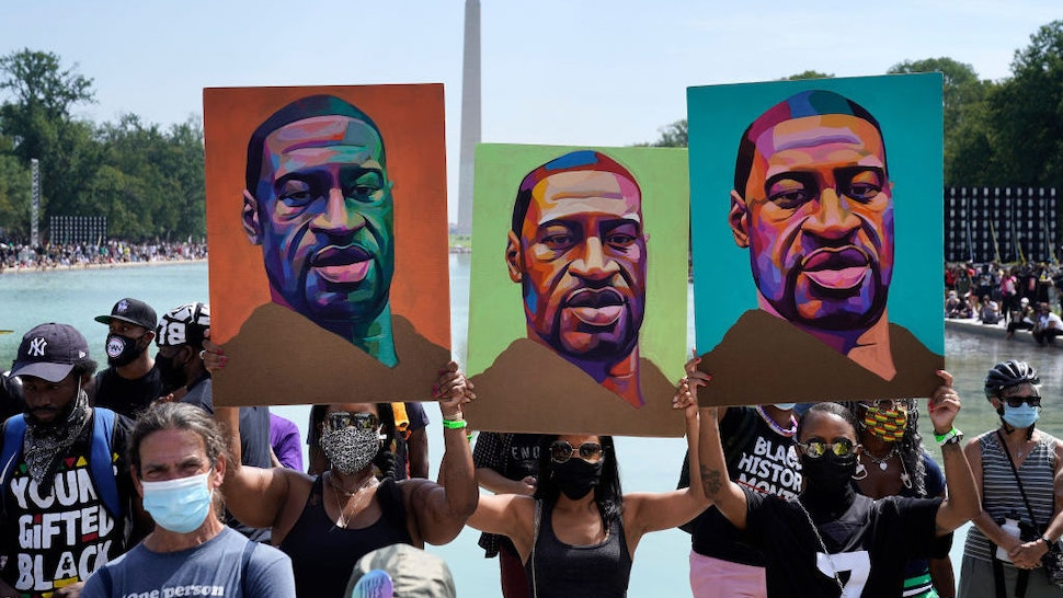 """WASHINGTON, DC - AUGUST 28: Attendees hold images of George Floyd as they participate in the March on Washington at the Lincoln Memorial August 28, 2020 in Washington, DC. Today marks the 57th anniversary of Rev. Martin Luther King Jr.'s """"I Have A Dream"""" speech at the same location. (Photo by Drew Angerer/Getty Images)"""
