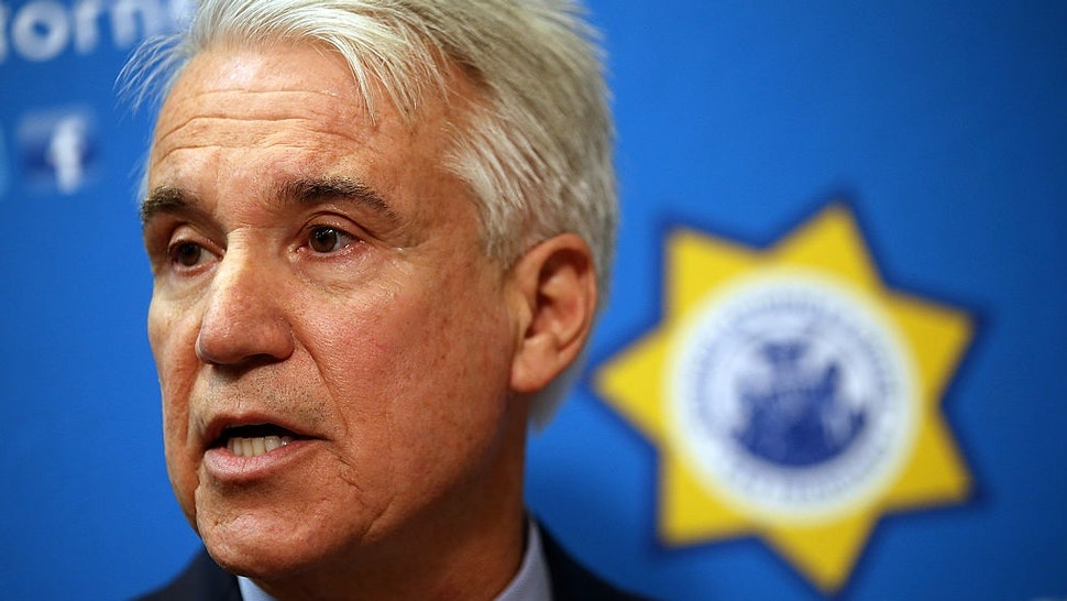 SAN FRANCISCO, CA - DECEMBER 09: San Francisco district attorney George Gascon speaks during a new conference to announce a civil consumer protection action against rideshare company Uber on December 9, 2014 in San Francisco, California.