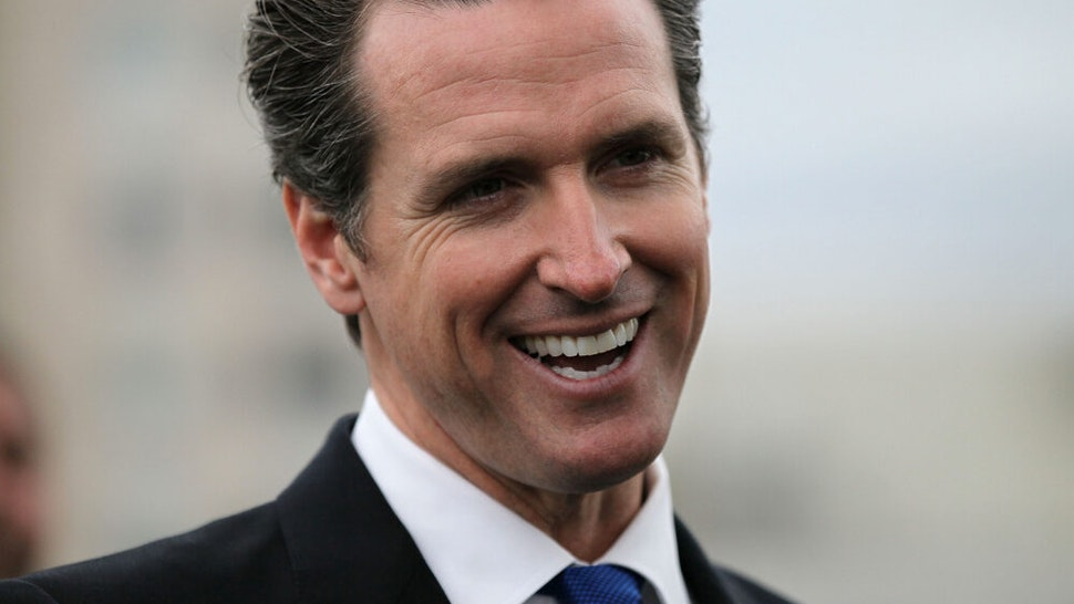 SAN FRANCISCO - MAY 25: San Francisco mayor Gavin Newsom smiles during a news conference May 25, 2010 in San Francisco, California. Mayor Newsom signed fee deferment legislation that will stimulate development and and generate construction jobs by allowing developers to defer upfront city development impact fees.