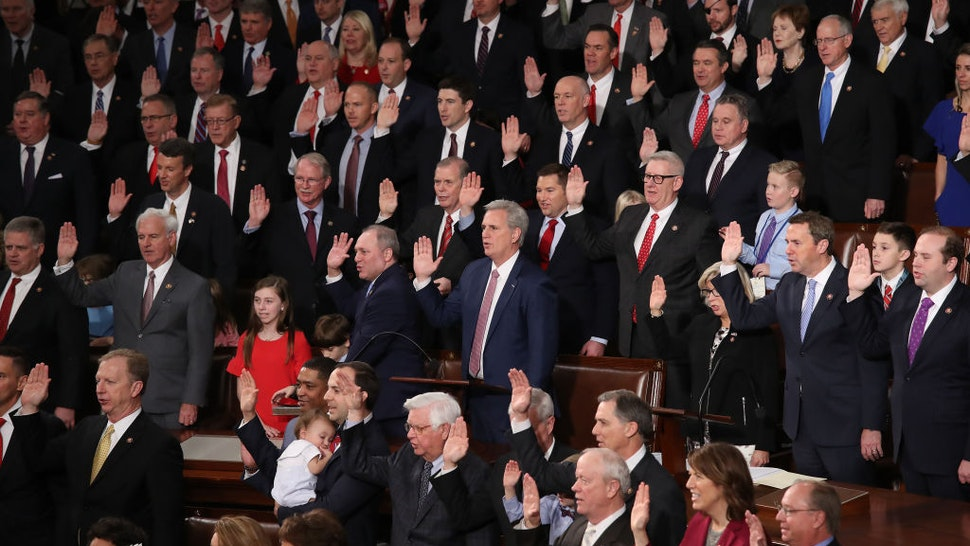 WASHINGTON, DC - JANUARY 03: Republican members of the House of Representatives are sworn in during the first session of the 116th Congress at the U.S. Capitol January 03, 2019 in Washington, DC. Under the cloud of a partial federal government shutdown, Speaker of the House Nancy Pelosi reclaimed her former title as Speaker and her fellow Democrats will take control of the House of Representatives for the second time in eight years. (Photo by Win McNamee/Getty Images)
