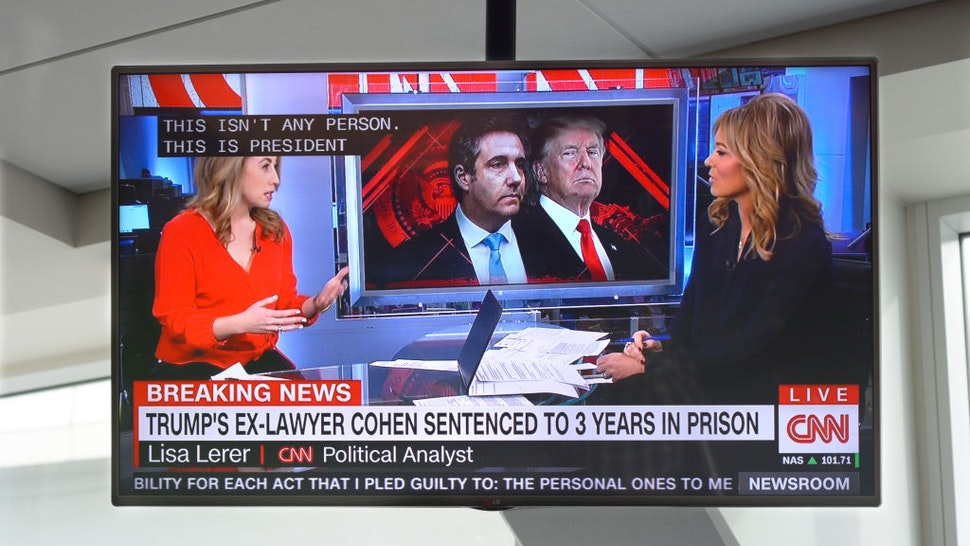 A television monitor at Dallas/Fort Worth International Airport shows a CNN news broadcast with CNN anchor Brooke Baldwin on the day President Trump's former lawyer, Michael Cohen, was sentenced to a prison term.