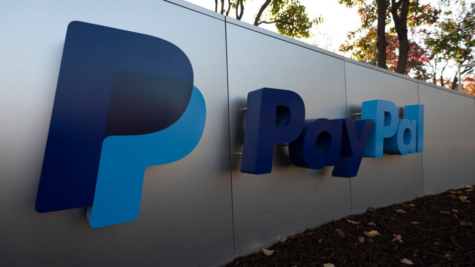 PayPal logo can be seen at its office in San Jose, California, United States on November 23, 2019. PayPal has agreed to acquire Honey Science Corporation, a rapidly-growing technology platform for shopping and rewards, for approximately $4 billion. (Photo by Yichuan Cao/NurPhoto via Getty Images)