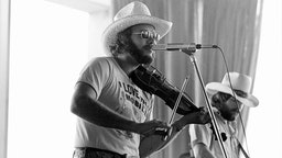 ATLANTA - MAY 26: Hank Williams Jr. performs for a record industry audience at Stouffer's Hotel on May 26, 1977 in Atlanta, Georgia. ( Photo by Tom Hill/Getty Images)