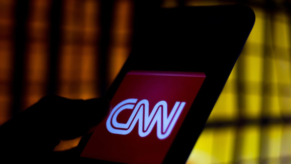 In this photo illustration a CNN logo seen displayed on a smartphone.