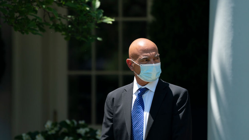 Moncef Slaoui, the former head of GlaxoSmithKlines vaccines division, listens as U.S. President Donald Trump delivers remarks about coronavirus vaccine development in the Rose Garden of the White House on May 15, 2020 in Washington, DC.