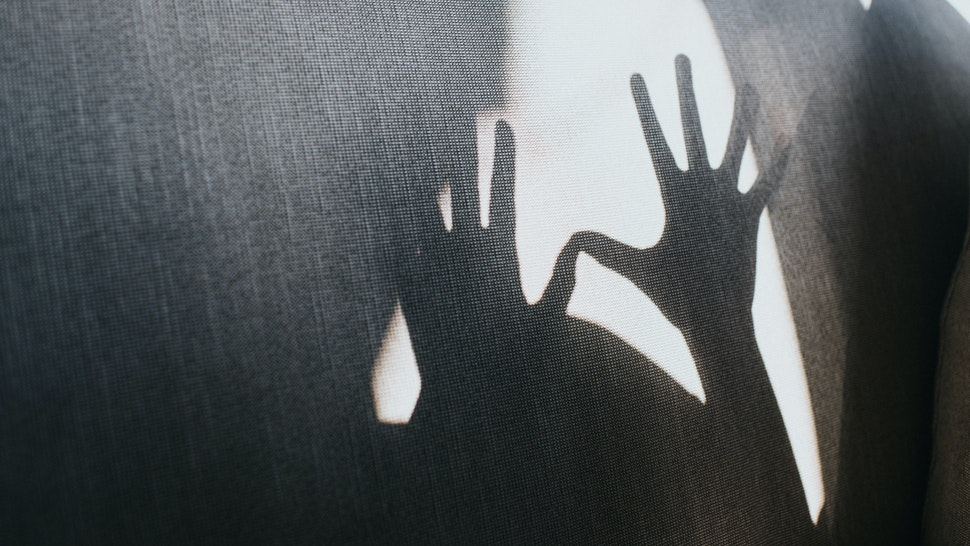 Defensive outstretched hands creating a shadow.