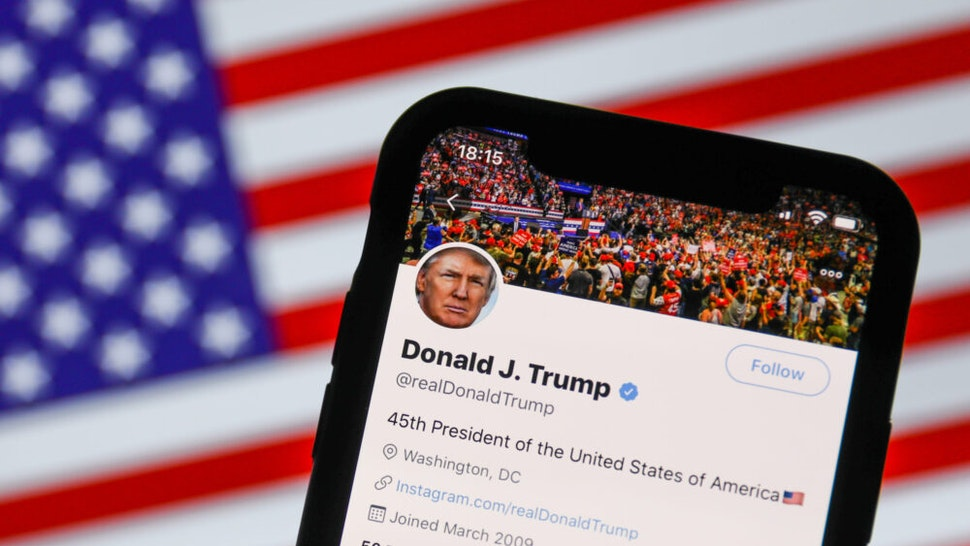 Twitter feed of the President of the USA Donald Trump is seen displayed on a phone screen with American flag in the background in this illustration photo taken on August 2, 2020. President of the USA Donald Trump said that Chinese app TikTok will be banned in the United States.
