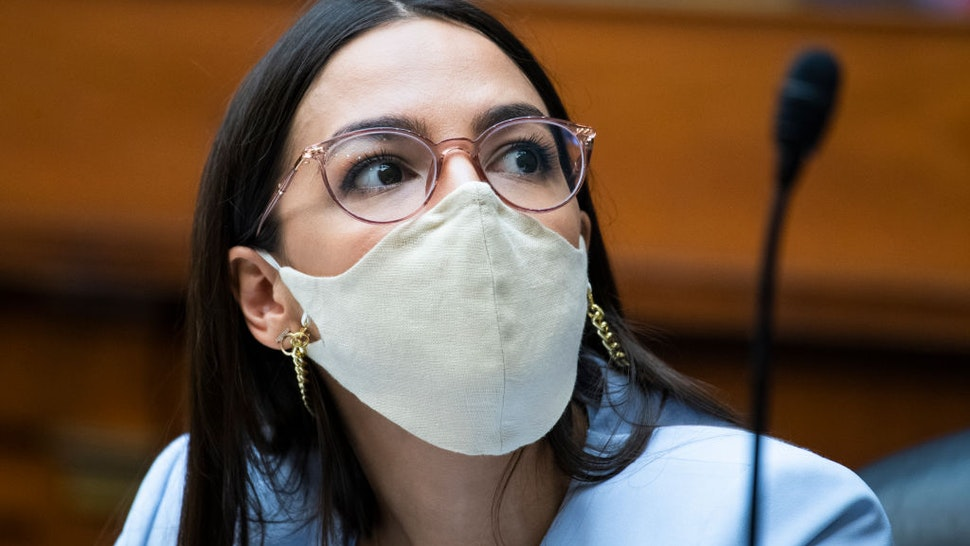 Representative Alexandria Ocasio-Cortez (D-NY), is seen as U.S. Postal Service Postmaster General Louis DeJoy testifies during a hearing before the House Oversight and Reform Committee on August 24, 2020 on Capitol Hill in Washington, DC.