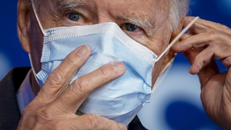 WILMINGTON, DE - OCTOBER 28: Democratic presidential nominee Joe Biden puts on his face mask after making remarks about the Affordable Care Act and COVID-19 after attending a virtual coronavirus briefing with medical experts at The Queen theater on October 28, 2020 in Wilmington, Delaware. Participants in the briefing include former U.S. Surgeon General Dr. Vivek Murthy, Director for Science in the Public Interest Dr. David Kessler, New York University professor Dr. Celine Grounder, and Yale University professor of medicine Dr. Marcella Nunez-Smith.
