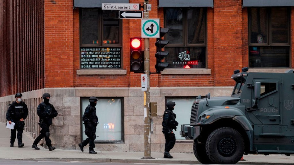 Montreal police respond to a possible hostage-taking at the Ubisoft office in the Mile End, on the corner of Saint-Laurent and Saint-Viateur Sts., in Montreal, Quebec on November 13, 2020.
