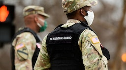 """Members of the New York Army National Guards prepare to close a road near the White House in Washington, D.C., U.S., on Tuesday, Jan. 5, 2021. Washington's mayor,Muriel Bowser, urged residents not to engage with any protesters """"seeking confrontation"""" and requested NationalGuardhelp in anticipation of potential violence in tied to protests as Congress meets to certifyJoe Bidenas the next U.S. president. Photographer: Erin Scott/Bloomberg via Getty Images"""