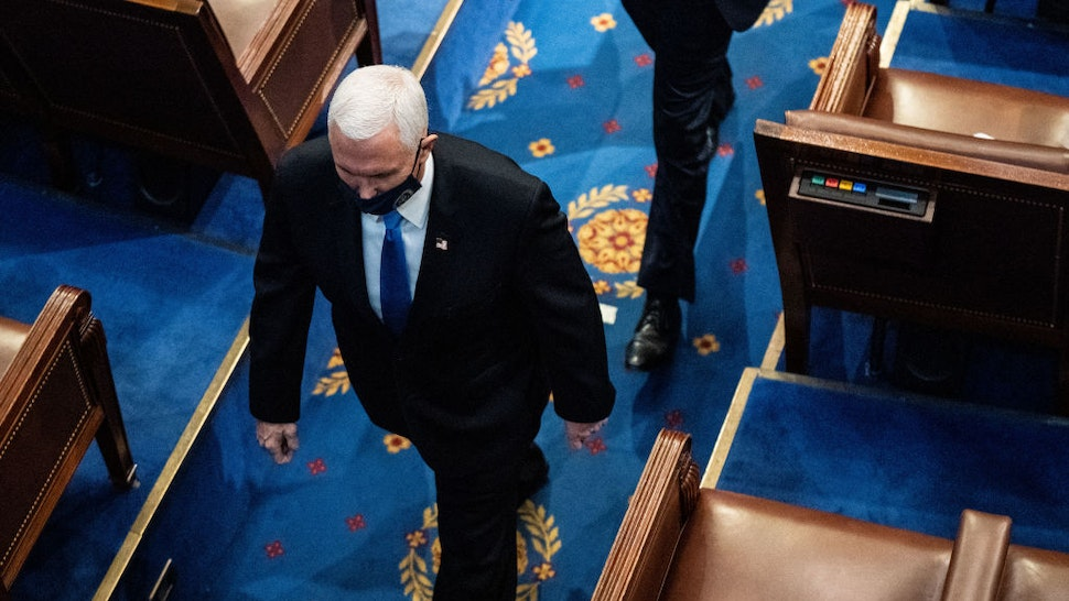 WASHINGTON, DC - JANUARY 06: U.S. Vice President Mike Pence walks off the House floor during a joint session of Congress to certify the 2020 Electoral College results on January 6, 2021 in Washington, DC. Congress held a joint session today to ratify President-elect Joe Biden's 306-232 Electoral College win over President Donald Trump. A group of Republican senators said they would reject the Electoral College votes of several states unless Congress appointed a commission to audit the election results. (Photo by Erin Schaff-Pool/Getty Images)