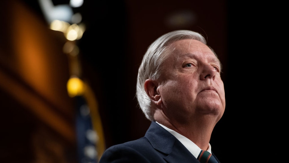 Senator Lindsey Graham, a Republican from South Carolina, listens during a news conference at the U.S. Capitol in Washington, D.C., U.S., on Thursday, Jan. 7, 2021.