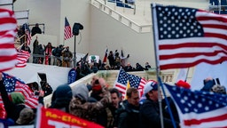 Supporters of US President Donald Trump clash with the US Capitol police during a riot at the US Capitol on January 6, 2021, in Washington, DC.
