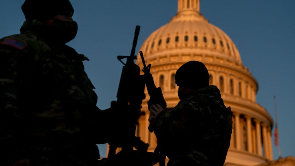 WASHINGTON, DC - JANUARY 13: Weapons are distributed to members of the National Guard outside the U.S. Capitol on January 13, 2021 in Washington, DC. Security has been increased throughout Washington following the breach of the U.S. Capitol last Wednesday, and leading up to the Presidential inauguration.