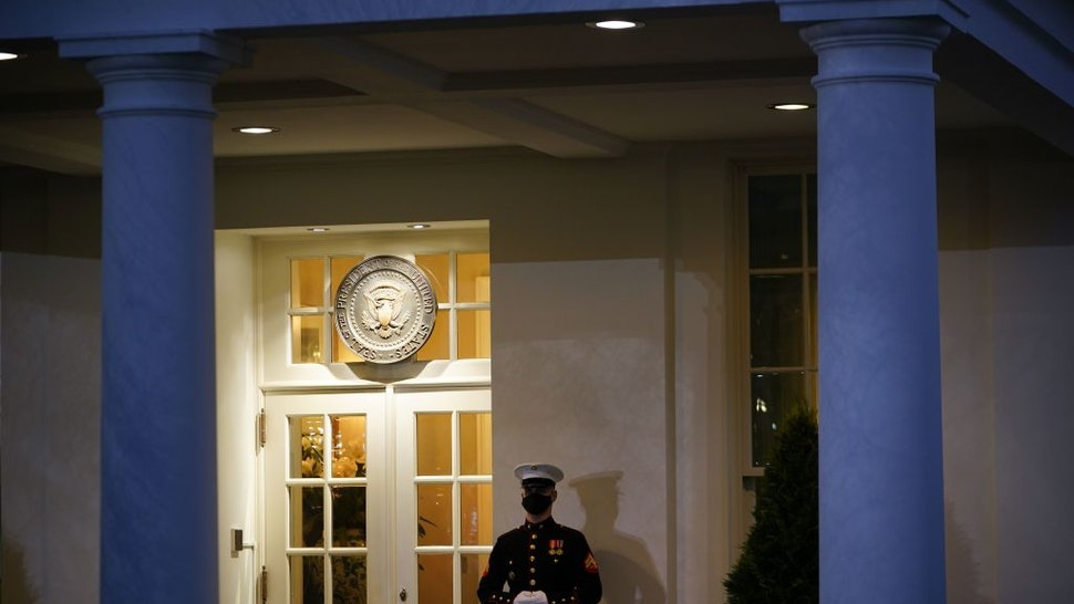 A US Marine stands guard outside of the West Wing at dusk on US President Donald Trump's final full day in office, in Washington, DC on January 19, 2021. - President Donald Trump began his final full day in the White House on January 19, 2021 with a long list of possible pardons to dish out before snubbing his successor Joe Biden's inauguration and leaving for Florida. On January 20, 2021 at noon, Biden will be sworn in and the Trump presidency will end, turning the page on some of the most disruptive, divisive years the United States has seen since the 1960s. (Photo by MANDEL NGAN / AFP) (Photo by MANDEL NGAN/AFP via Getty Images)