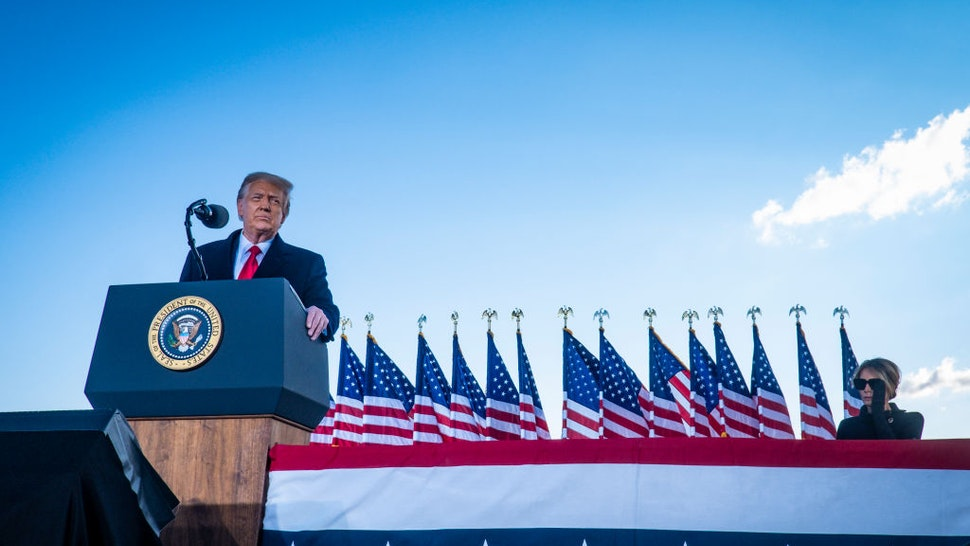 President Donald Trump speaks to supporters at Joint Base Andrews before boarding Air Force One for his last time as President on January 20, 2021 in Joint Base Andrews, Maryland.