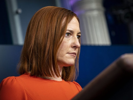 Jen Psaki, White House press secretary, listens during a news conference in the James S. Brady Press Briefing Room at the White House in Washington, D.C., U.S., on Thursday, Jan. 21, 2021. Biden in his first full day in office plans to issue a sweeping set of executive orders to tackle the raging Covid-19 pandemic that will rapidly reverse or refashion many of his predecessor's most heavily criticized policies.