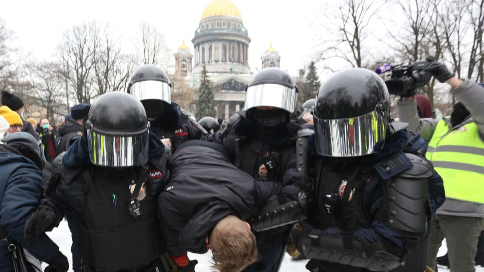Police officers detain a protester during a rally in support of Alexei Navalny Politica in St. Petersburg, Russia, on January 23, 2021. Opposition politician Alexei Navalny has returned after poisoning from Germany to Russia and was detained at the airport in Moscow. (Photo by Valya Egorshin/NurPhoto via Getty Images)