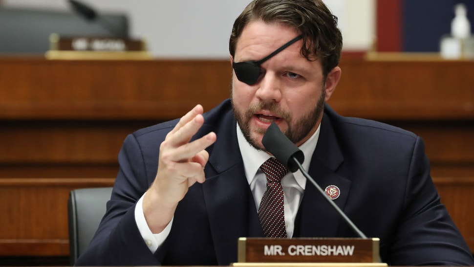 WASHINGTON, DC - SEPTEMBER 17: House Homeland Security Committee member Rep. Dan Crenshaw (R-TX) questions witnesses during a hearing on 'worldwide threats to the homeland' in the Rayburn House Office Building on Capitol Hill September 17, 2020 in Washington, DC. Committee Chairman Bennie Thompson (D-MS) said he would issue a subpoena for acting Homeland Security Secretary Chad Wolf after he did not show for the hearing. An August Government Accountability Office report found that Wolf's appointment by the Trump Administration, which has regularly skirted the Senate confirmation process, was invalid and a violation of the Federal Vacancies Reform Act. (Photo by Chip Somodevilla/Getty Images)