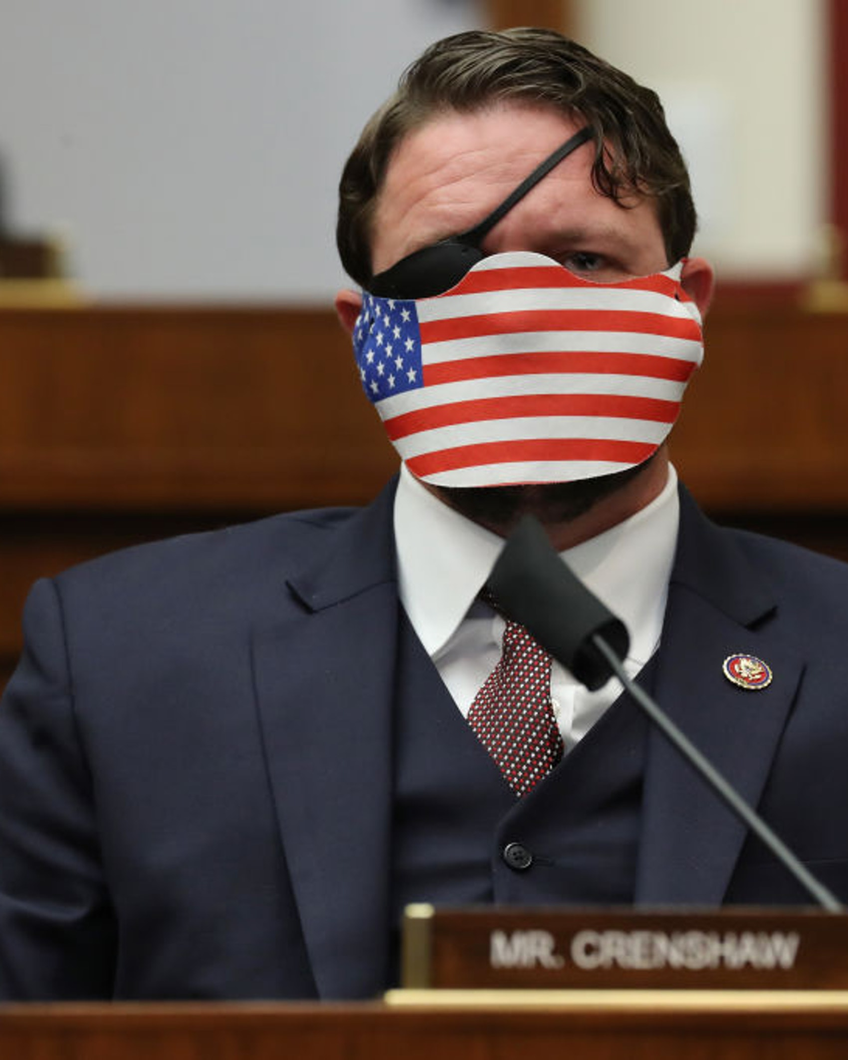 WASHINGTON, DC - SEPTEMBER 17: Wearing a face mask to reduce the risk posed by the coronavirus, House Homeland Security Committee member Rep. Dan Crenshaw (R-TX) attends a hearing on 'worldwide threats to the homeland' in the Rayburn House Office Building on Capitol Hill September 17, 2020 in Washington, DC. Committee Chairman Bennie Thompson (D-MS) said he would issue a subpoena for acting Homeland Security Secretary Chad Wolf after he did not show for the hearing. An August Government Accountability Office report found that Wolf's appointment by the Trump Administration, which has regularly skirted the Senate confirmation process, was invalid and a violation of the Federal Vacancies Reform Act. (Photo by Chip Somodevilla/Getty Images)