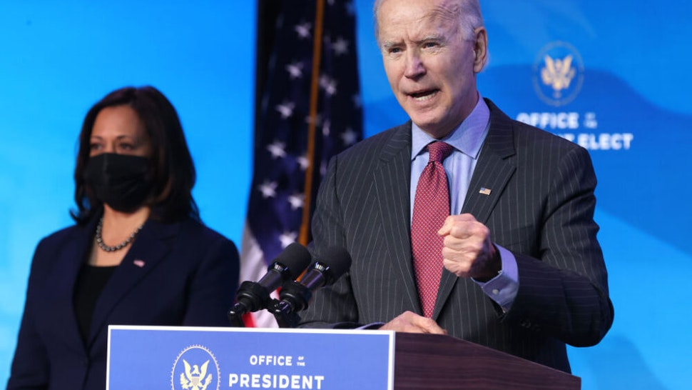 WILMINGTON, DELAWARE - JANUARY 08: U.S. Vice President-elect Kamala Harris (L) looks on as U.S. President-elect Joe Biden (R) delivers remarks after he announced cabinet nominees that will round out his economic team, including secretaries of commerce and labor, at The Queen theater on January 08, 2021 in Wilmington, Delaware. Biden announced he is nominating Rhode Island Gov. Gina Raimondo as his commerce secretary, Boston Mayor Martin J. Walsh his labor secretary and Isabel Guzman, a former Obama administration official, as head of the Small Business Administration.