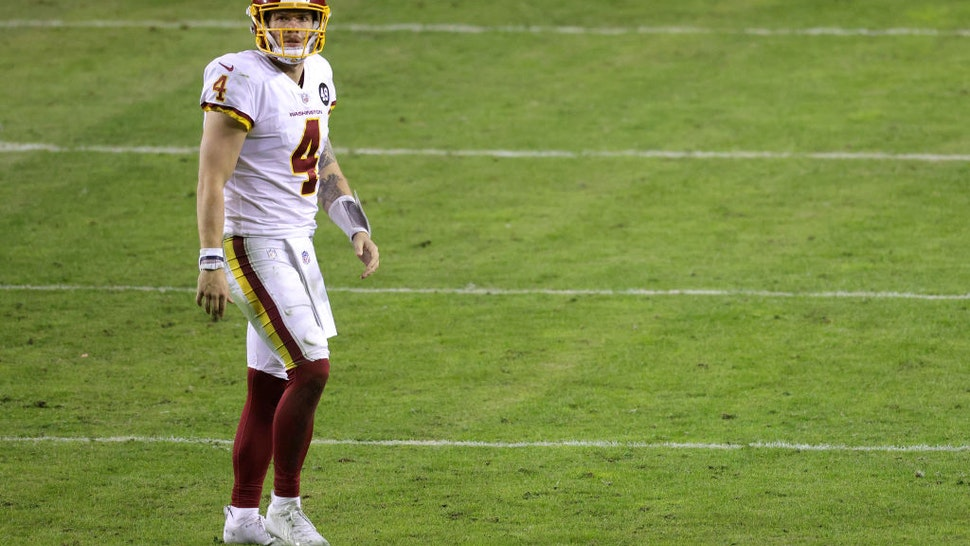 Quarterback Taylor Heinicke #4 of the Washington Football Team looks on after an incomplete pass against the Tampa Bay Buccaneers during the NFC Wild Card playoff game at FedExField on January 09, 2021 in Landover, Maryland.