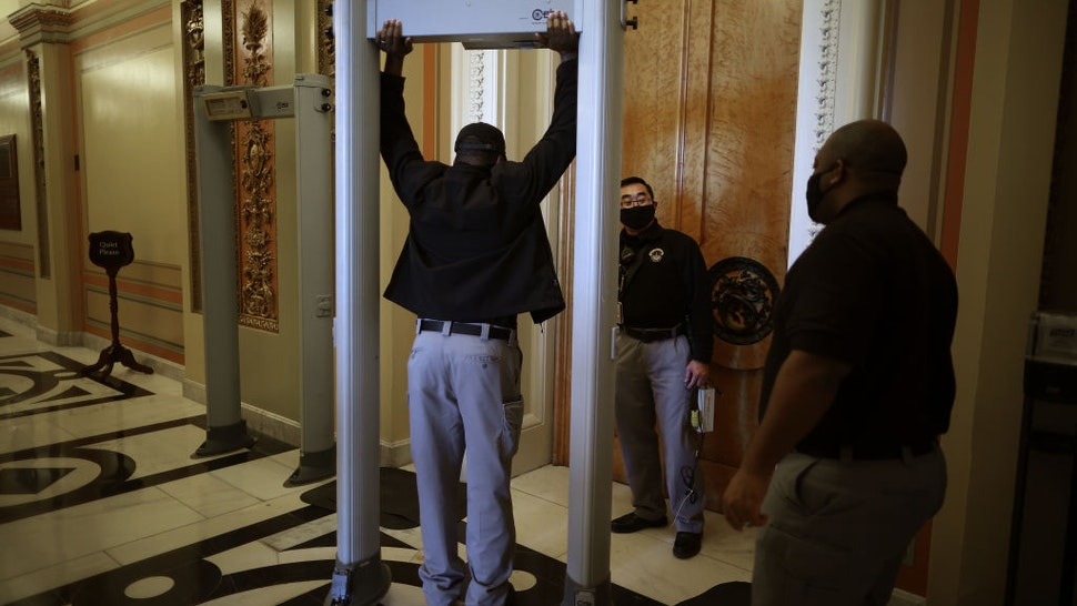 WASHINGTON, DC - JANUARY 12: U.S. Capitol Police install a metal detector at the doors of the House of Representatives Chamber January 12, 2021 in Washington, DC. At the direction of President Donald Trump, a mob attacked the U.S. Capitol on January 6 and security has been tightened ahead of next week's presidential inauguration. (Photo by Chip Somodevilla/Getty Images)
