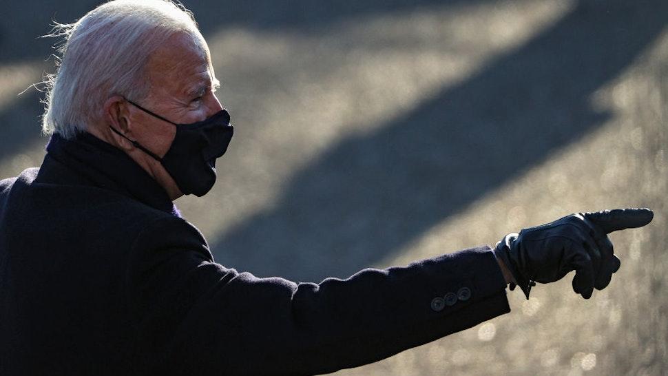 U.S. President Joe Biden walks the abbreviated parade route after Biden's inauguration on January 20, 2021 in Washington, DC.