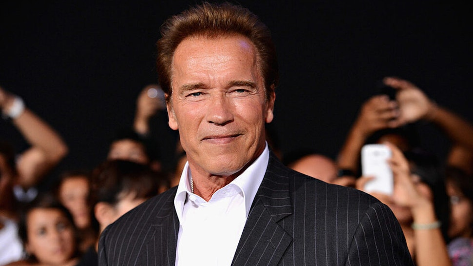 "HOLLYWOOD, CA - AUGUST 15: Actor Arnold Schwarzenegger arrives at Lionsgate Films' ""The Expendables 2"" premiere on August 15, 2012 in Hollywood, California."