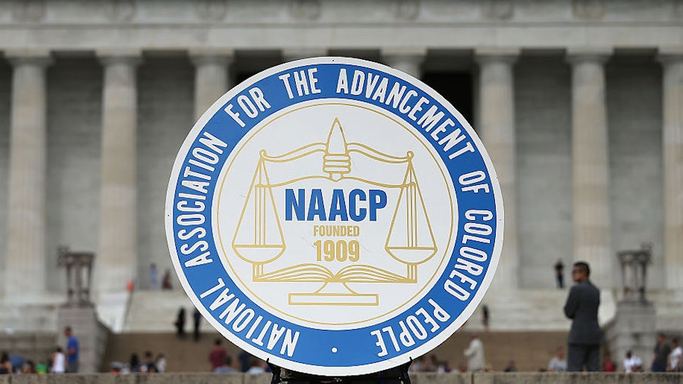 A logo is seen for the National Association for the Advancement of Colored People as NAACP President and CEO Cornell William Brooks speaks during a press conference at the Lincoln Memorial June 15, 2015 in Washington, DC.