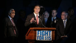 NEW YORK, NY - NOVEMBER 10: New York Governor Andrew Cuomo (C) speaks during as low wage workers and supporters protest for a $15 an hour minimum wage on November 10, 2015 at Foley Square in New York, United States. The protesters are demanding action from state legislators and presidential candidates to raise the minimum wage to $15 USD an hour. (Photo by Cem Ozdel/Anadolu Agency/Getty Images)