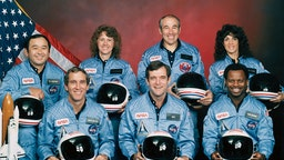 (Original Caption) Five astronauts and two payload specialists make up the STS 51-L crew, scheduled to fly aboard the Space Shuttle Challenger in January of 1986. Crewmembers are (left to right, front row) astronauts Michael J. Smith, Francis R. (Dick) Scobee and Ronald E. McNair; and Ellison S. Onizuka, Sharon Christa McAuliffe, Gregory Jarvis and Judith A. Resnik. McAuliffe and Jarvis are payload specialists, representing the Teacher in Space Project and Hughes Co., respectively.