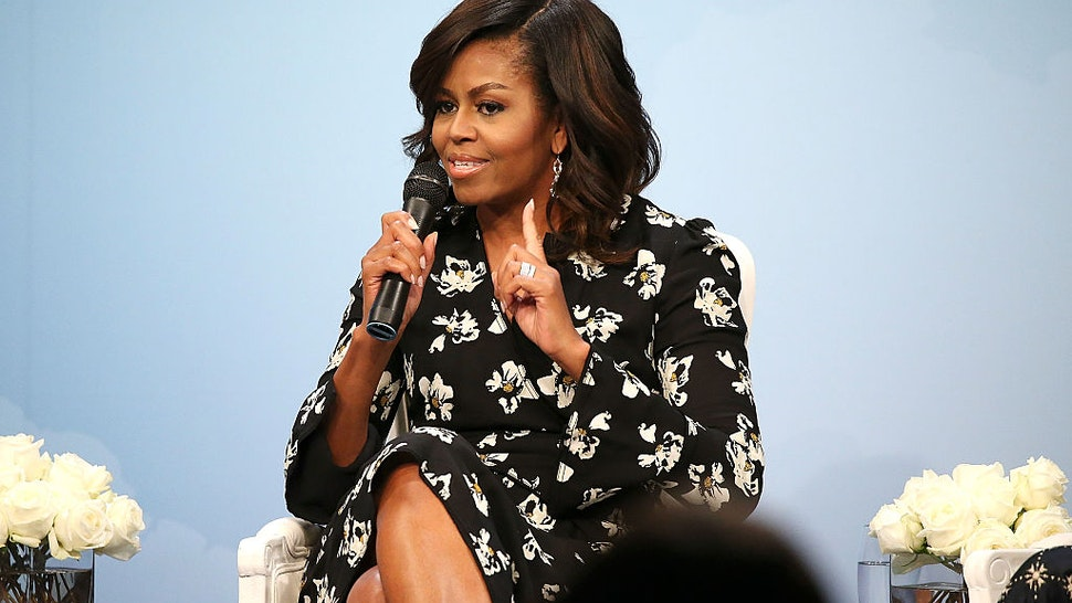 "WASHINGTON, DC - OCTOBER 11: First Lady of the United States Michelle Obama speaks during a panel discussion at Glamour Hosts ""A Brighter Future: A Global Conversation on Girls' Education"" with First Lady Michelle Obama at The Newseum on October 11, 2016 in Washington, DC. (Photo by Paul Morigi/Getty Images for Glamour)"