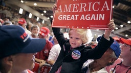 JACKSONVILLE, FL - NOVEMBER 03: Six-year-old Eli Townsend dresses like Republican presidential nominee Donald Trump during a campaign rally at the Jacksonville Equestrian Center November 3, 2016 in Jacksonville, Florida. With less than a week before Election Day in the United States, Trump and his opponent, Democratic presidential nominee Hillary Clinton, are campaigning in key battleground states that each must win to take the White House.