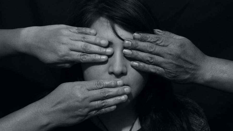 Close-Up Of A Hands On Womans Face - stock photo