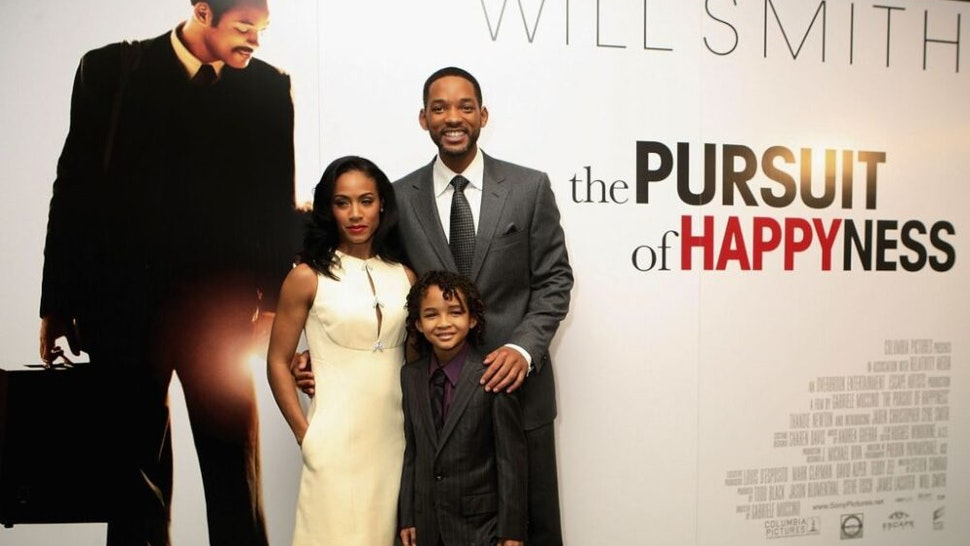"""LONDON - JANUARY 08: (UK TABLOID NEWSPAPERS OUT) Actor Will Smith, his son Jaden and wife Jada Pinkett Smith attend a charity lunch in aid of The Prince's Trust prior to the UK premiere this evening of """"The Pursuit of Happyness"""" at the Dorchester Hotel on January 8, 2007 in London, England."""