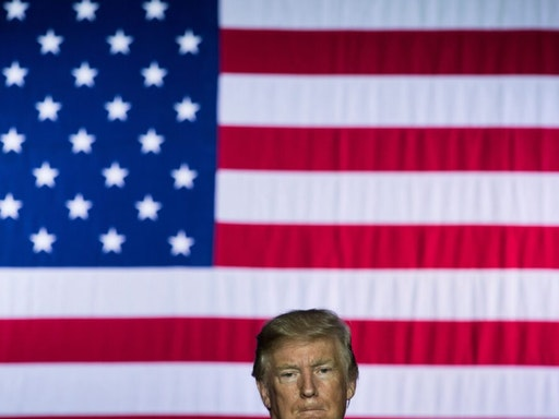 TOPSHOT - US President Donald Trump speaks about tax reform at the Indiana Farm Bureau building on the Indiana State Fairgrounds September 27, 2017 in Indianapolis, Indiana.