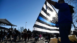 Bruce Workman shows his support holding the Thin Blue Line flag during the Zackari Parrish 5K run/walk at the Douglas County Fairgrounds February 03, 2018.