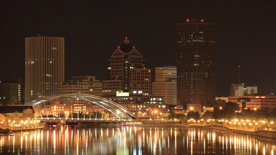 Rochester (NY) downtown in night. reflected on Genesee river.