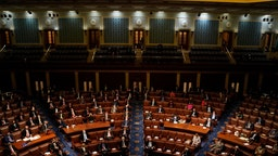 WASHINGTON, DC - JANUARY 07: Members of congress sit in the chamber during a joint session of the 117th Congress in the House Chamber of the U.S. Capitol where all the Electoral College votes from the States will be delivered and verified on Thursday, Jan. 7, 2021 in Washington, DC.