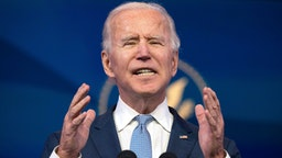 """US President-elect Joe Biden speaks at the Queen Theater on January 6, 2021, in Wilmington, Delaware. - Biden on Wednesday denounced the storming of the US Capitol as an """"insurrection"""" and demanded President Donald Trump go on television to call an end to the violent """"siege."""""""