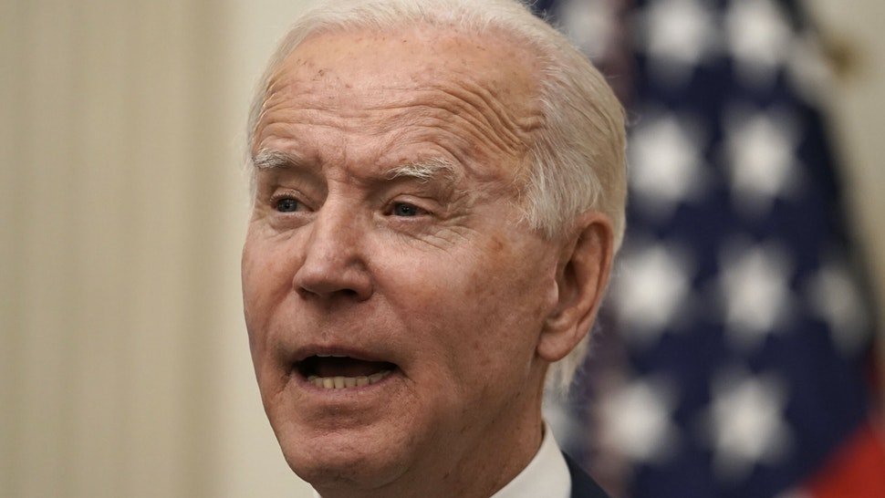 U.S. President Joe Biden speaks on his administrations response to the economic crisis in the State Dining Room of the White House in Washington, D.C., U.S., on Friday, Jan. 22, 2021. Biden will mark his third day in office with executive actions to boost food assistance for impoverished Americans and use federal contracts as a step toward his proposed nationwide minimum-wage hike, seeking immediate help for an economy struggling to cope with Covid-19.