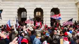 WASHINGTON, DC - JANUARY 06: A pro-Trump mob floods into the Capitol Building after breaking into it on January 6, 2021 in Washington, DC.