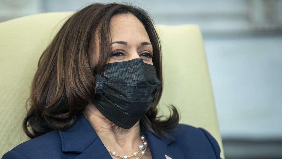 """U.S. Vice President Kamala Harris attends a meeting between Janet Yellen, U.S. Treasury secretary, and U.S. President Joe Biden, not pictured, in the Oval Office of the White House in Washington, D.C., U.S., on Friday, Jan. 29, 2021. Yellensaid she'll try to """"better understand"""" the financial risks of taking steps to combat climate change, while expressing support for Biden's decision to cancel the Keystone XL Pipeline."""
